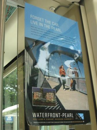 A condo ad on the Portland Streetcar