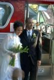 The 'just marrieds' by the wedding bus