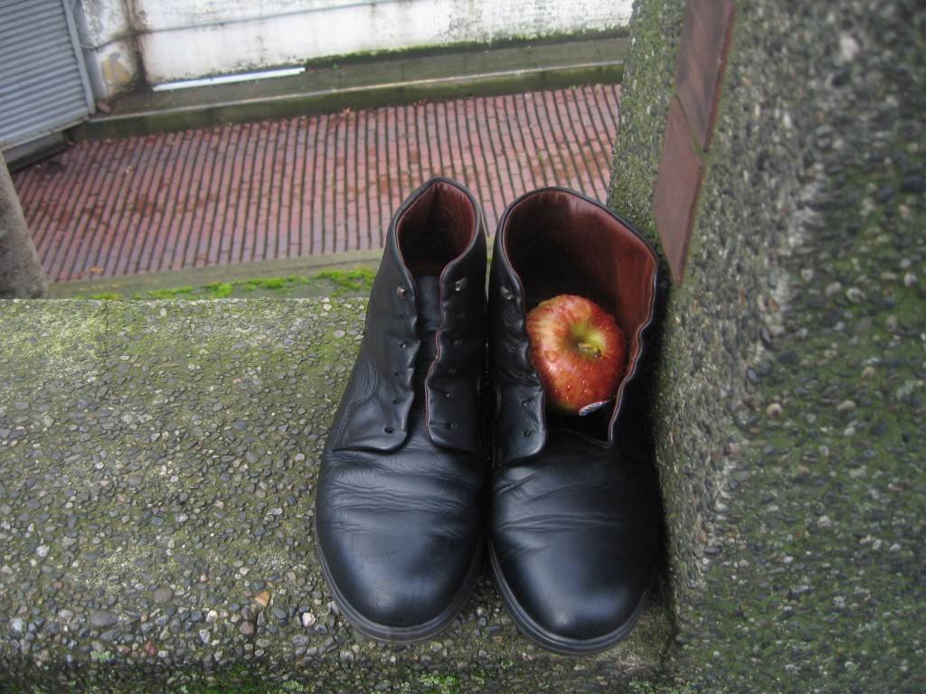 Apple & shoes at bus stop
