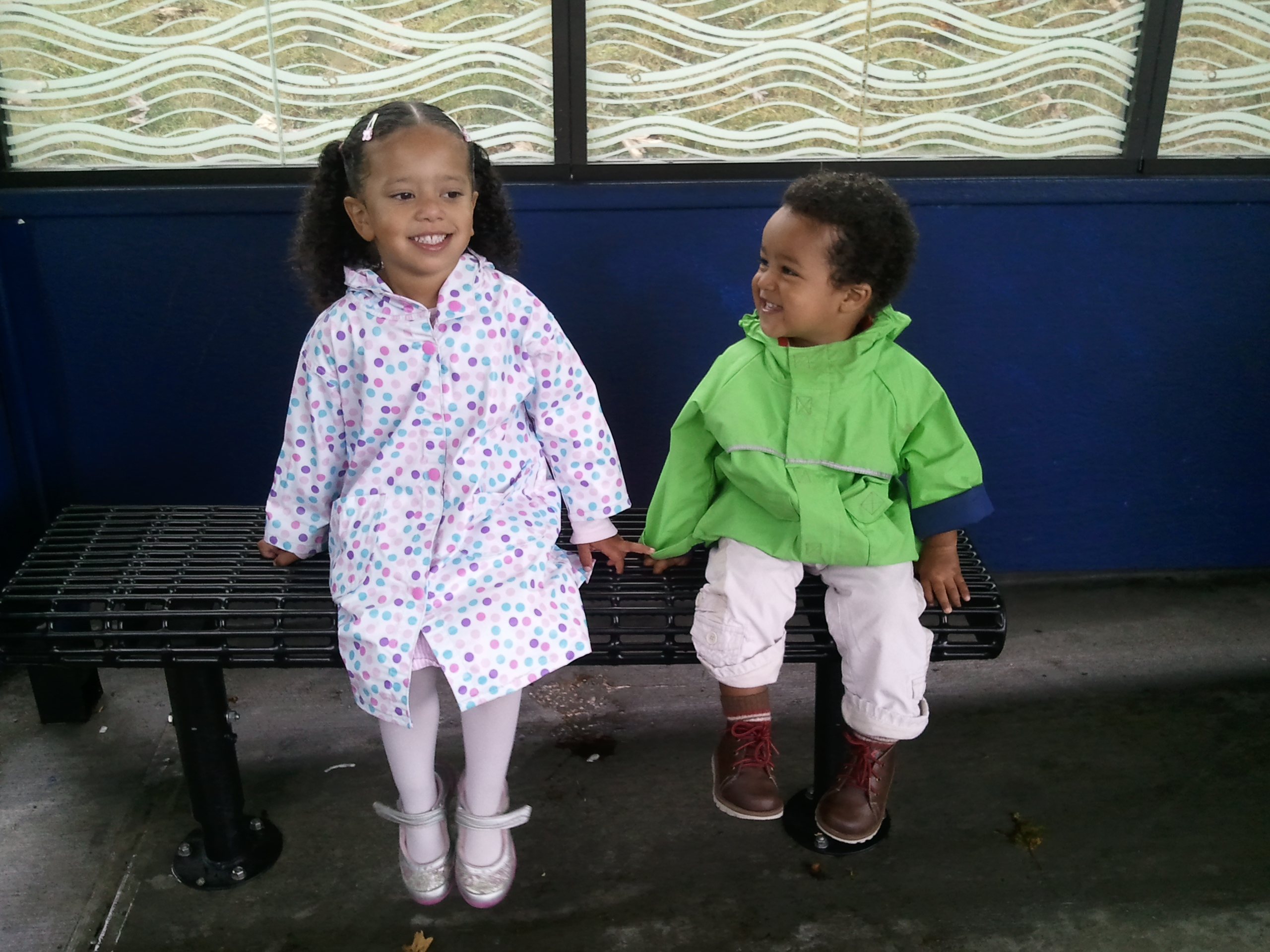 My two babies at a bus stop