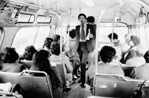 Bobby Seale, campaigning on a bus (source: NPR)