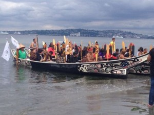Duwamish people in canoes on the Duwamish River