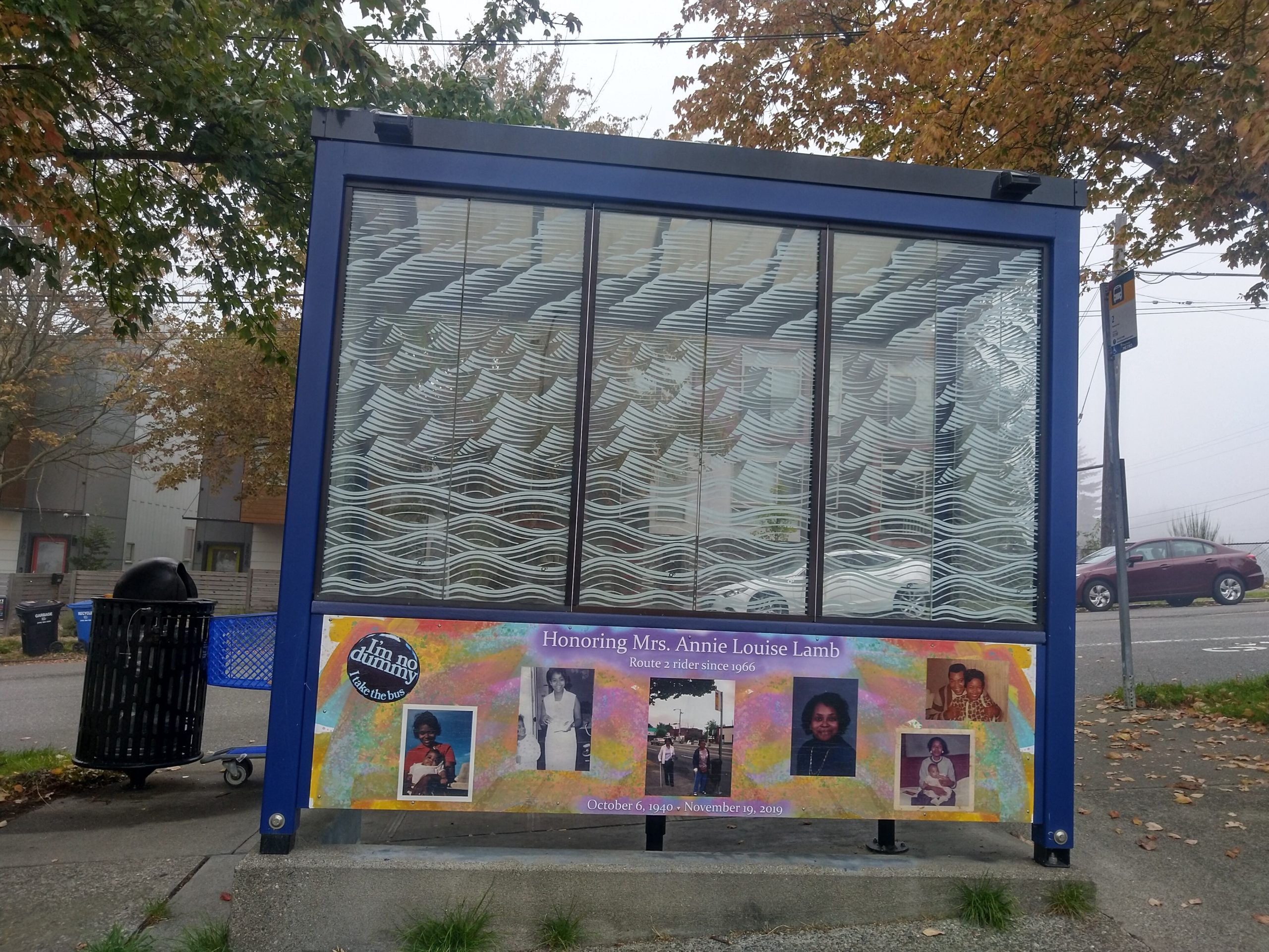 A bus shelter with a mural honoring Annie Lamb