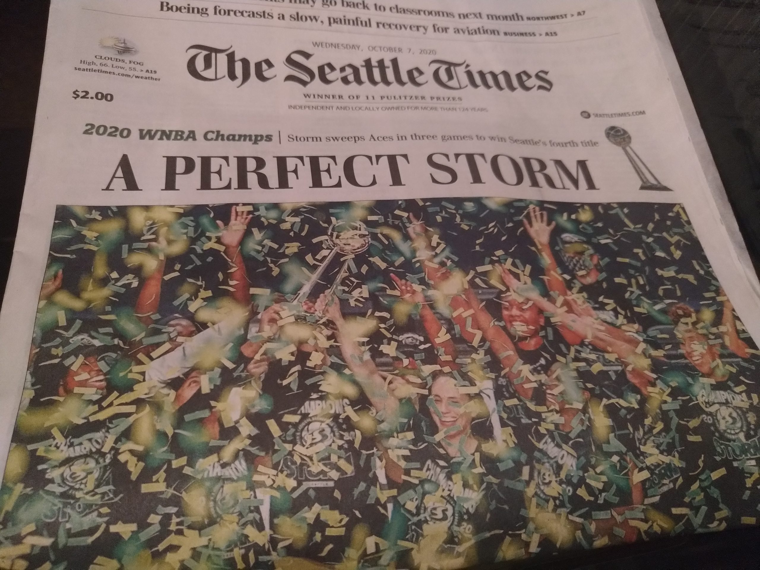 "Image description: A newspaper front page with the headline, ""A perfect Storm."" Below the headline is a photo of the Storm players, celebrating as green and yellow confetti falls around them."
